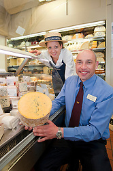 Andre Birckett Manager of Chatsworth Farm Shop and Sophie Hudson Senior Customer Service Assistant with the shops wide variety of cheeses..10  May 2012.Image © Paul David Drabble