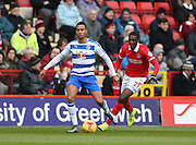 Reading midfielder Jordan Obita (11) and Charlton Athletic striker Yaya Sanogo (25) during the Sky Bet Championship match between Charlton Athletic and Reading at The Valley, London, England on 27 February 2016.