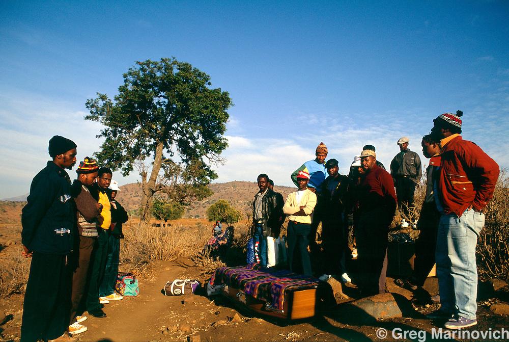 Msinga KwaZulu Natal, September 1995, South Africa. Family members prepare to bury a man killed in a clan feud in Msinga.
