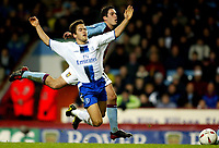 Photograph: Scott Heavey.<br />Aston Villa v Chelsea. Carling cup Quater Final. 17/12/2003.<br />Joe Cole goes down easily under pressure from Peter Whittingham
