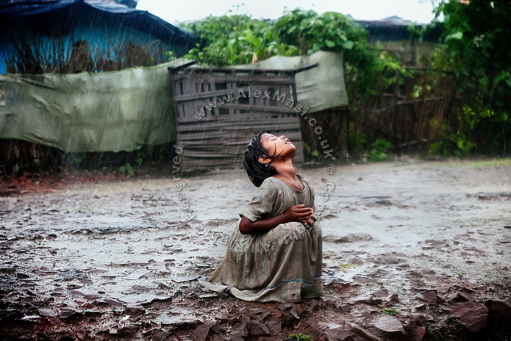 Poonam, 6, is revelling in the heavy monsoon rain in Oriya Basti, one of the water-contaminated colonies near the abandoned Union Carbide (now DOW Chemical) industrial complex in Bhopal, central India, site of the infamous '1984 Gas Disaster'. When the monsoon rain falls every year, it seeps through the buried, hazardous waste of Union Carbide, before proceeding to pollute the area's underground water reservoirs.