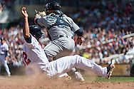 Aaron Hicks #32 of the Minnesota Twins slides safely into home plate ahead of the throw to Jesus Sucre #2 of the Seattle Mariners on June 2, 2013 at Target Field in Minneapolis, Minnesota.  The Twins defeated the Mariners 10 to 0.  Photo: Ben Krause