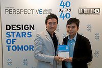 Architect and interior designer Dylan Kwok (R) receives his 40 Under 40 Perspective magazine award.