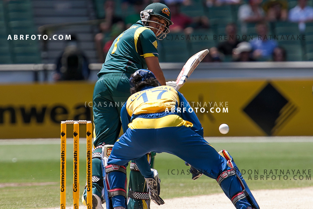 Phillip Hughes ducks a bouncer. ONE DAY INTERNATIONAL AUSTRALIA V SRI LANKA - 11th JANUARY 2013. Action from game 1 of the Commonwealth Bank Series Australia v Sri Lanka played at the Melbourne Cricket Ground in Melbourne,Victoria, Australia. Photo Asanka Brendon Ratnayake SMP Images.