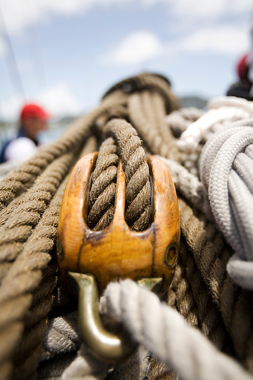 A traditional block and ropes on board the schooner yacht SY Altair during the 2008 Antigua Classic Yacht Regatta . This race is one of the worlds most prestigious traditional yacht races. It takes place annually off the cost of Antigua in the British West Indies. Antigua is a yachting haven, historically a British navy base in the times of Nelson.