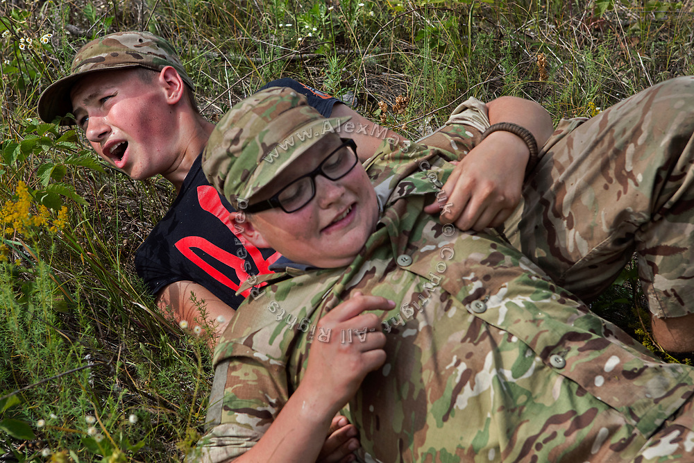 Youngsters participating to the ultra-nationalistic Azovets children's camp are learning about combat wounds and rapid evacuations from the battlefield, during tactical training on the banks of the Dnieper river, in Kiev, Ukraine's capital.