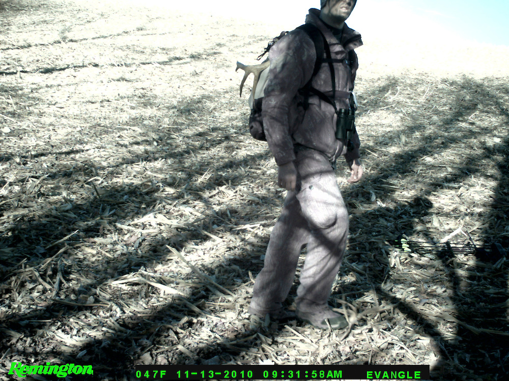 Photographer Zach Johnson is captured on a trail camera as he heads to his tree stand for an afternoon deer hunt.