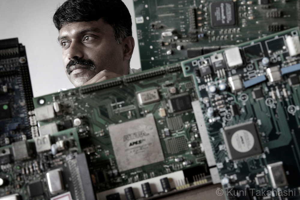 Chezi K. Ganesan, President of VinChip Systems, poses with electric board designed by his farm which specialize USB products, in Chennai, India on Sep 6, 2010. <br /> Photo by Kuni Takahashi