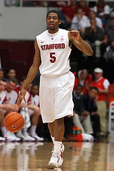 Feb 4, 2012; Stanford CA, USA; Stanford Cardinal guard Chasson Randle (5) dribbles the ball against the Arizona Wildcats during the first half at Maples Pavilion.  Arizona defeated Stanford 56-43. Mandatory Credit: Jason O. Watson-US PRESSWIRE