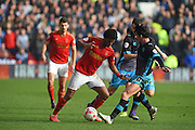 Nottingham Forest midfielder Ryan Mendes   battles with Sheffield Wednesday midfielder Kieran Lee during the Sky Bet Championship match between Nottingham Forest and Sheffield Wednesday at the City Ground, Nottingham, England on 12 March 2016. Photo by Jon Hobley.