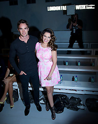 © Licensed to London News Pictures. 15/09/2012. London, UK.  Kelly Brook (right) with boyfriend Thom Evans at Issa London catwalk show at London Fashion Week Spring/Summer 2013 on September 15, 2012. Photo credit : Ben Cawthra/LNP
