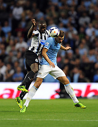 Newcastle United's Mapou Yanga-Mbiwa battles for the high ball with Manchester City's Edin Dzeko  - Photo mandatory by-line: Joe Meredith/JMP - Tel: Mobile: 07966 386802 19/08/2013 - SPORT - FOOTBALL - Etihad Stadium - Manchester - Manchester City V Newcastle United - Barclays Premier League
