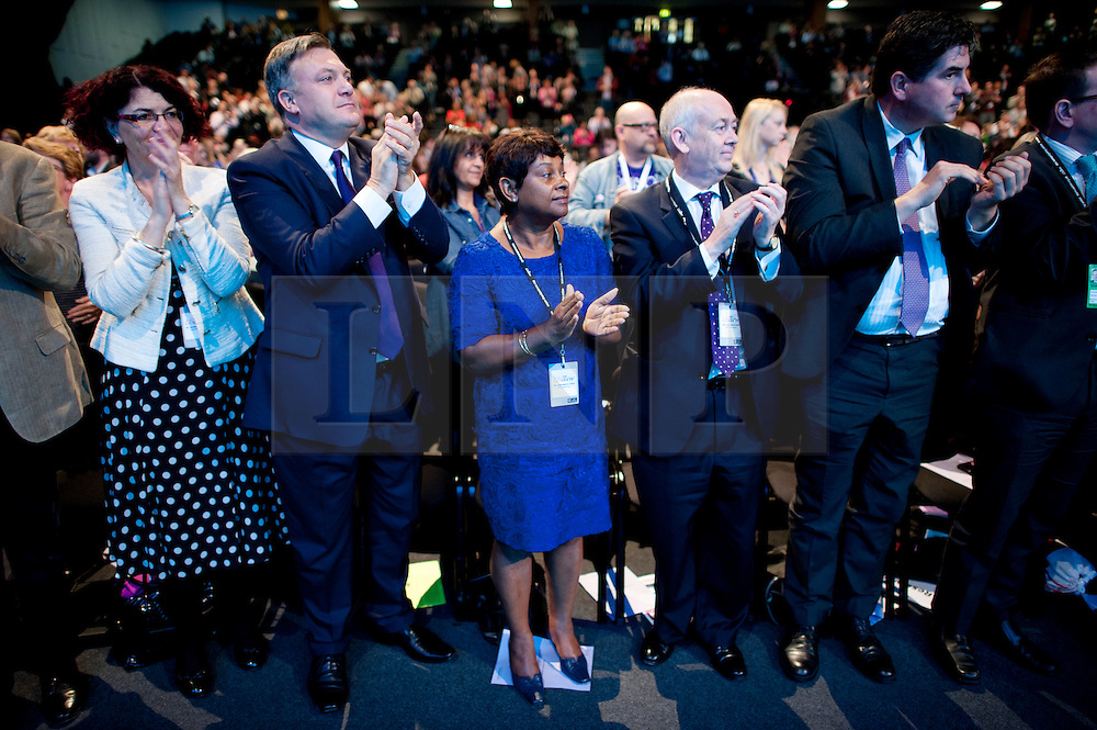 © London News Pictures. 25/09/2013 . Brighton, UK. Shadow Chancellor ED BALLS (second left) and DOREEN LAWRENCE (centre) listing to Yvette Cooper speak on the last day of the  2013 Labour Party Conference at The Brighton Centre. Photo credit : Ben Cawthra/LNP