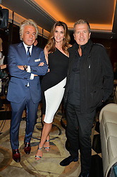 Left to right, GIANCARLO GIAMMETTI, CINDY CRAWFORD and MARIO TESTINO at the London launch of Casamigos Tequila hosted by Rande Gerber, George Clooney & Michael Meldman and to celebrate Cindy Crawford's new book 'Becoming' held at The Beaumont Hotel, Brown Hart Gardens, 8 Balderton Street, London on 1st October 2015.