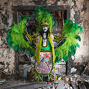 J'wan Boudreaux, Spy Boy of the Golden Eagles Mardi Gras Indians, poses for a photo on Mardi Gras February 28, 2017, in New Orleans, LA. This house, located on Washington Avenue, caught fire on Mardi Gras 2015 and has not been rebuilt.