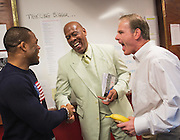 Former Husker wrestler and Olympic gold medalist Jordan Burroughs laughs with Mike Allen, the coordinator of wrestling officials for the Big Ten, and Husker head coach Mark Manning before the Husker's duel against Iowa at the Bob Devaney Sports Center in Lincoln, Neb., on Jan. 24, 2016. Iowa defeated Nebraska.