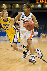 Virginia guard Kristen London (20) dribbles past UCSB guard Ariana Gnekow (12).  The #4 seed/#24 ranked Virginia Cavaliers defeated the #13 seed Santa Barbara Gauchos 86-52 in the first round of the 2008 NCAA Division 1 Women's Basketball Championship at the Ted Constant Convocation Center in Norfolk, VA on March 23, 2008