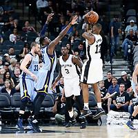 04 April 2017: San Antonio Spurs guard Jonathon Simmons (17) takes a jump shot over Memphis Grizzlies forward James Ennis III (8) and Memphis Grizzlies center Marc Gasol (33) during the San Antonio Spurs 95-89 OT victory over the Memphis Grizzlies, at the AT&T Center, San Antonio, Texas, USA.