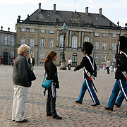 Change of the guard at Amalienborg, the winter home of the Danish Royal Family, located in Copenhagen's Frederiksstaden district. It consists of four identical palace façades with rococo interiors around an octagonal courtyard.  MR, Model Release<br /> Photography by Jose More