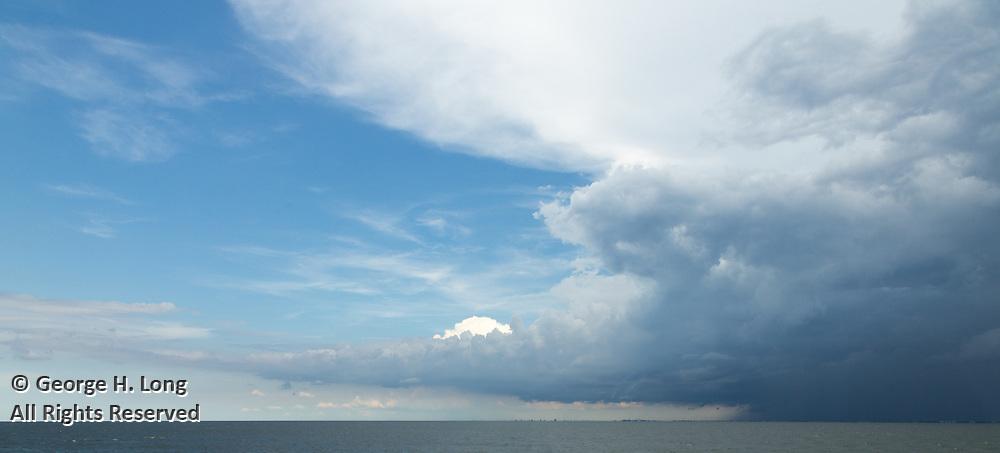 Thunderstorm over Lake Pontchartrain; heading south on the Lake Pontchartrain Causeway bridge