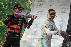 MELBOURNE, March 17, 2019  First-placed Mercedes driver Valtteri Bottas (R) of Finland and third-placed Red Bull driver Max Verstappen of the Netherlands celebrate during the awarding ceremony of Formula 1 Australian Grand Prix 2019 at the Albert Park in Melbourne, Australia, March 17, 2019. (Credit Image: © Bai Xuefei/Xinhua via ZUMA Wire)
