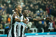 Newcastle United midfielder Yoan Gouffran (#20) celebrates Newcastle United's second goal (2-0) with Newcastle United midfielder Christian Atsu (#30) during the EFL Sky Bet Championship match between Newcastle United and Cardiff City at St. James's Park, Newcastle, England on 5 November 2016. Photo by Craig Doyle.