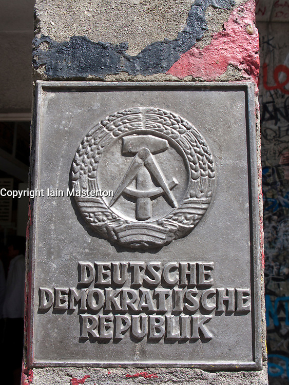 Detail of old East German sign at Checkpoint Charlie in Berlin Germany