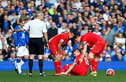 Alberto Moreno of Liverpool picks up a knock - Mandatory byline: Matt McNulty/JMP - 07966 386802 - 04/10/2015 - FOOTBALL - Goodison Park - Liverpool, England - Everton  v Liverpool - Barclays Premier League
