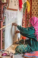 Traditional rug weaver.