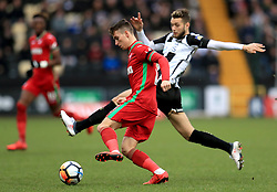 Swansea City's Tom Carroll (front) and Nott's County's Jorge Grant battle for the ball during the Emirates FA Cup, fourth round match at Meadow Lane, Nottingham.