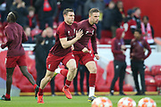 Liverpool midfielder James Milner (7) and Liverpool midfielder Jordan Henderson (14) warming up during the Champions League Quarter-Final Leg 1 of 2 match between Liverpool and FC Porto at Anfield, Liverpool, England on 9 April 2019.