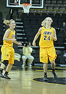 December 30, 2011: Iowa Hawkeyes guard Kamille Wahlin (2) and Iowa Hawkeyes guard Jaime Printy (24) all smilies after a three point basket during the NCAA women's basketball game between the Northwestern Wildcats and the Iowa Hawkeyes at Carver-Hawkeye Arena in Iowa City, Iowa on Wednesday, December 30, 2011.