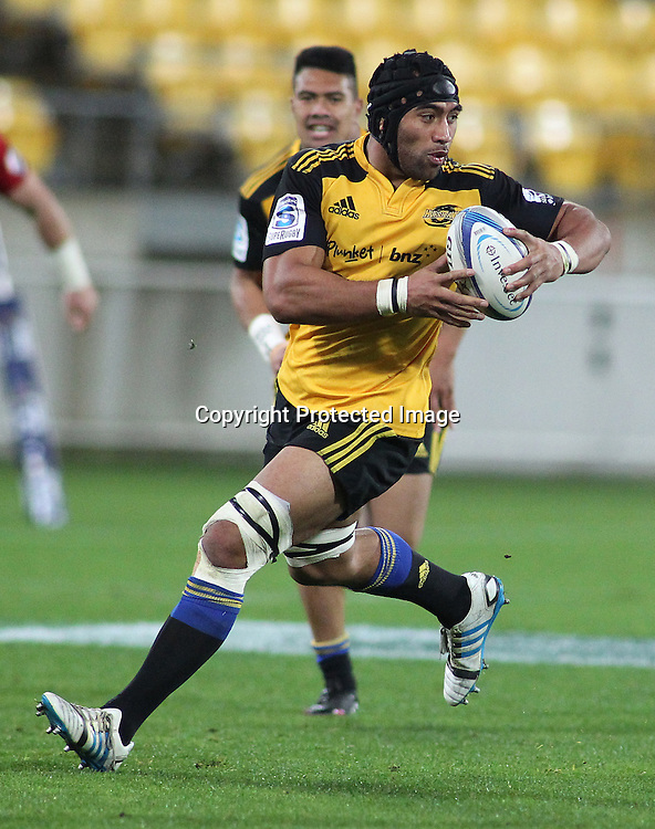 Hurricanes' Victor Vito with support from Ardie Savea runs the ball during the Round 15 Super Rugby match, between the Hurricanes & Chiefs. Westpac Stadium, Wellington. 24 May 2014. Photo.: Grant Down / www.photosport.co.nz