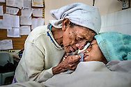 A mother comforts her daughter after waking from a six month coma Feb 28, 2015 at Occidente Hospitol in Santa Rosa de Copan, Honduras. CAMO, Central American Medical Outreach provides medical needs to thousands in and around Honduras, from general medicine, to gynecological, breast exams, basic dental procedures, neurosurgery, plastic surgery, or ophthalmology. Photo Ken Cedeno
