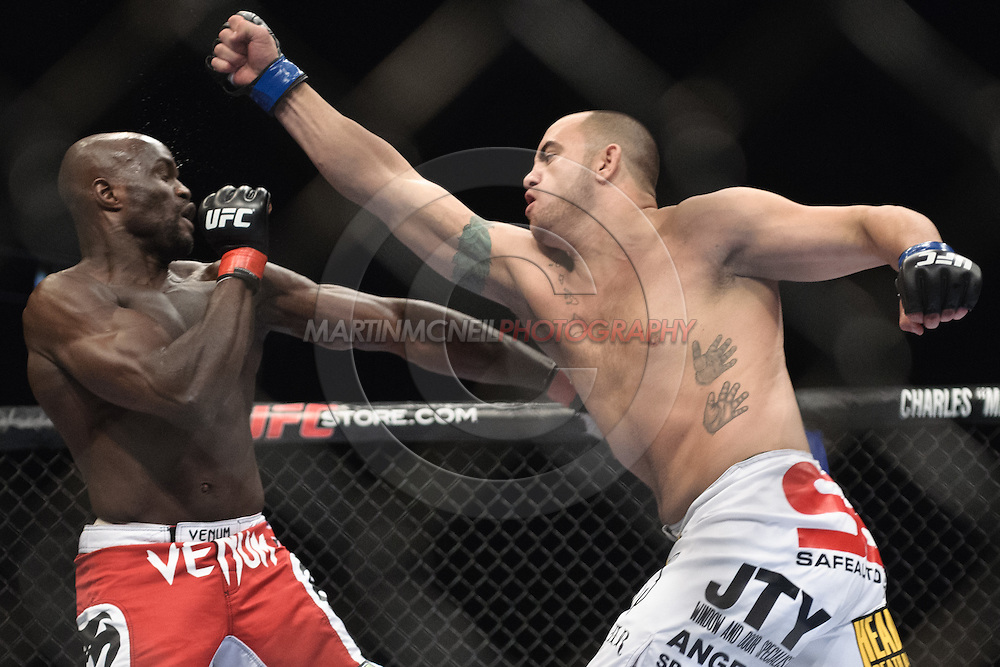 "LONDON, ENGLAND, OCTOBER 2010: Cheick Kongo (left) is stunned by a right hand from Travis Browne during ""UFC 120: Bisping vs. Akiyama"" inside the O2 Arena in Greenwich, London"