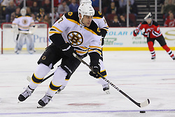 Jan 19; Newark, NJ, USA; Boston Bruins left wing Milan Lucic (17) skates with the puck during the first period of their game against the New Jersey Devils at the Prudential Center.