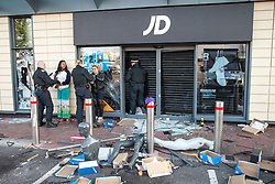 © Licensed to London News Pictures . 07/08/2011 . London , UK . Police detain looters outside a branch of JD Sports at Tottenham Hale Retail Park . Overnight rioting and looting in Tottenham , following a protest against the police shooting of Mark Duggan . Photo credit : Joel Goodman/LNP