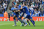 Leicester City defender Wes Morgan (5) scores a goal and celebrates to make the score 1-0 during the Barclays Premier League match between Leicester City and Southampton at the King Power Stadium, Leicester, England on 3 April 2016. Photo by Simon Davies.