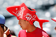 ANAHEIM, CA - JULY 21:  A fan wears a foam hat with the number for Mike Trout #27 of the Los Angeles Angels of Anaheim during the game against the Texas Rangers on Saturday, July 21, 2012 at Angel Stadium in Anaheim, California. The Rangers won the game 9-2. (Photo by Paul Spinelli/MLB Photos via Getty Images)