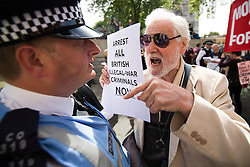 © Licensed to London News Pictures . 06/07/2016 . London , UK . Stop the War protest outside the venue as the report is delivered . Scene outside the Queen Elizabeth II Conference Centre in Westminster , ahead of the publication of the Chilcot Inquiry's report in to the 2003 invasion of Iraq . Photo credit : Joel Goodman/LNP