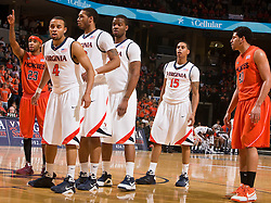 Virginia guard Calvin Baker (4), forward Mike Scott (32), forward Jamil Tucker (12), and guard Sylven Landesberg (15) wait for an inbounds pass against VT.  The Virginia Cavaliers defeated the Virginia Tech Hokies 75-61 at the John Paul Jones Arena on the Grounds of the University of Virginia in Charlottesville, VA on February 18, 2009.