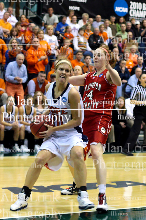 20 March 2010: Jenny Cowen grimaces as she works to get past Zoe Unruh. The Flying Dutch of Hope College fall to the Bears of Washington University 65-59 in the Championship Game of the Division 3 Women's NCAA Basketball Championship the at the Shirk Center at Illinois Wesleyan in Bloomington Illinois.