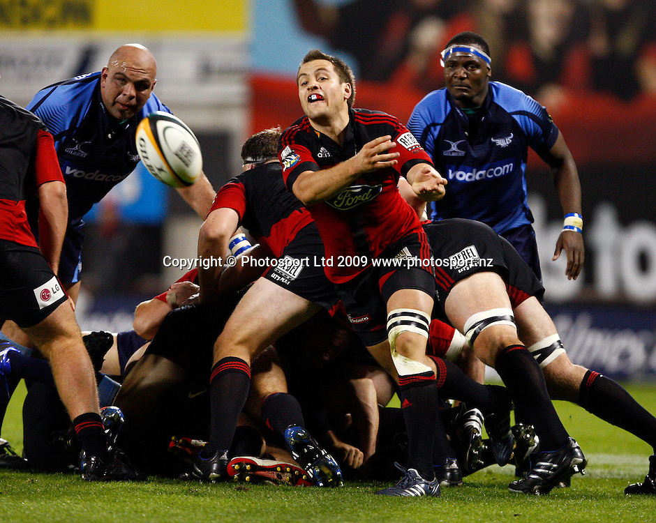 Crusaders Tim bateman clears the ball from a ruck during the Super 14 rugby union match, Canterbury Crusaders v Vodacom Bulls, AMI Stadium, Christchurch. 3 April 2009. Photo: Simon Watts/PHOTOSPORT