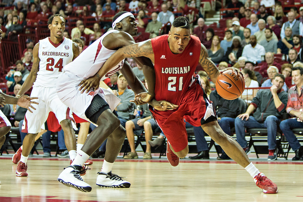 FAYETTEVILLE, AR - NOVEMBER 15:  Shawn Long #21 of the Louisiana Ragin' Cajuns drives to the basket against Bobby Portis #10 of the Arkansas Razorbacks at Bud Walton Arena on November 15, 2013 in Fayetteville, Arkansas.  The Razorbacks defeated the Ragin' Cajuns 76-63.  (Photo by Wesley Hitt/Getty Images) *** Local Caption *** Shawn Long; Bobby Portis
