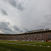 Rain clouds hover above the field during the game at Harvard Stadium on May 10, 2014 in Boston, Massachusetts. (Photo by Elan Kawesch)