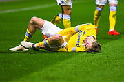 Patrick Bamford of Leeds United (9) is down injured during the EFL Sky Bet Championship match between Preston North End and Leeds United at Deepdale, Preston, England on 9 April 2019.