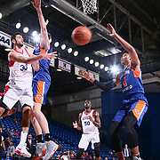 Delaware 87ers Guard and 76ers Assignee FURKAN KORKMAZ (30) passes the ball under the rim in the first half of a NBA G-league regular season basketball game between the Delaware 87ers and the Westchester Knicks (New York Knicks) Tuesday, Nov. 07, 2017, at The Bob Carpenter Sports Convocation Center in Newark, DEL