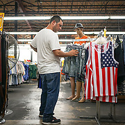 HIALEAH, FLORIDA - JUNE 24, 2016<br /> Esbel Ruiz  as he shops for  clothing  in Noooo (&ntilde;oooo) Que Barato,  in Hialeah, Florida. The store sells all kinds of goods and is a very popular stop for Cubans who are traveling to Cuba to stock up on supplies to carry to relatives in the island nation. Ruiz was buying items to send with to Cuba carried by someone else.<br /> (Photo by Angel Valentin/Freelance)