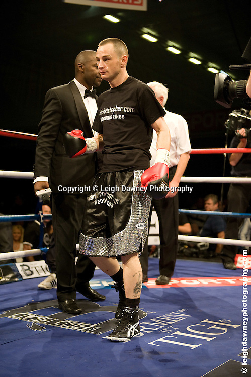 Ian Napa (black/red shorts) defeats Gary Davies at the Bolton Arena, Bolton, UK on 23rd September 2009. Frank Maloney Promotions. photo credit © Leigh Dawney