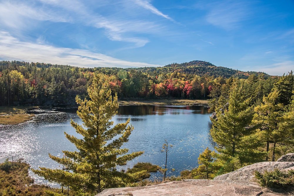 Hogback Mountain rises behind Wetmore Pond, the area is popular fall color hiking area near Marquette, Michigan.